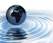 globe above ripples of water